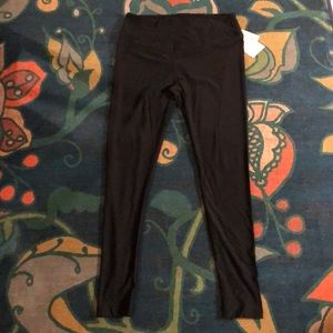 NWT Lularoe black leggings (size T/C)